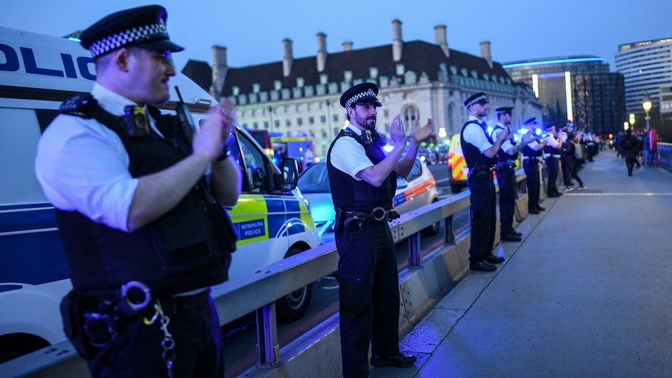 Picture of clapping police officers on bridge