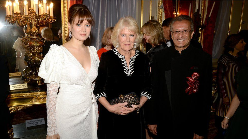 Mr Amersi with his partner Nadezhda Rodicheva and the Duchess of Cornwall at a charity fashion show in 2018