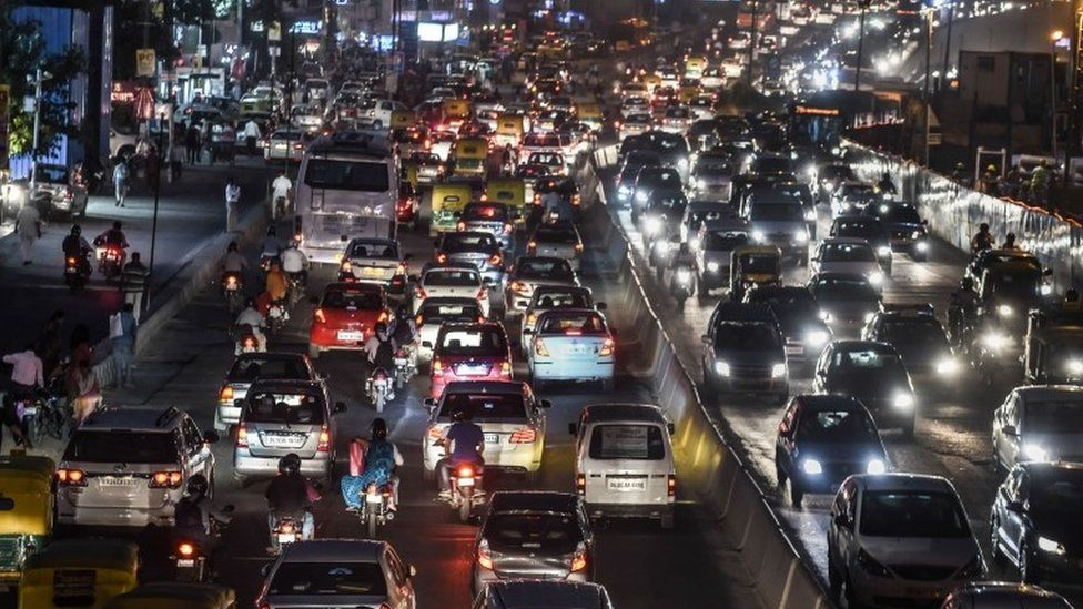 In this photo taken on October 15, 2015, commuters in their vehicles clog a busy artery in southern New Delhi