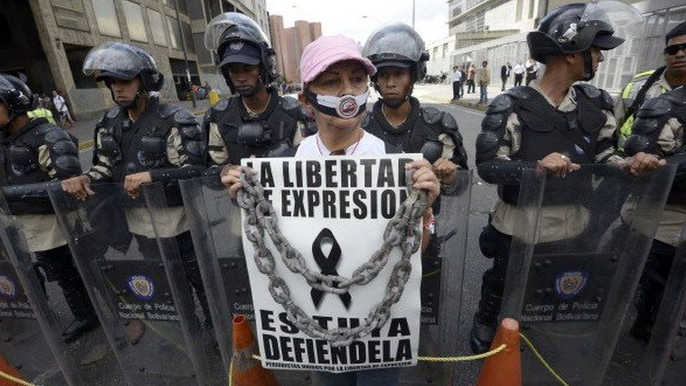 A woman takes part in a protest outside the CADIVI headquarters in Caracas in February 2013. About 500 newspaper workers demanded to the government the release of US dollars to buy paper, presently in shortage in Venezuela