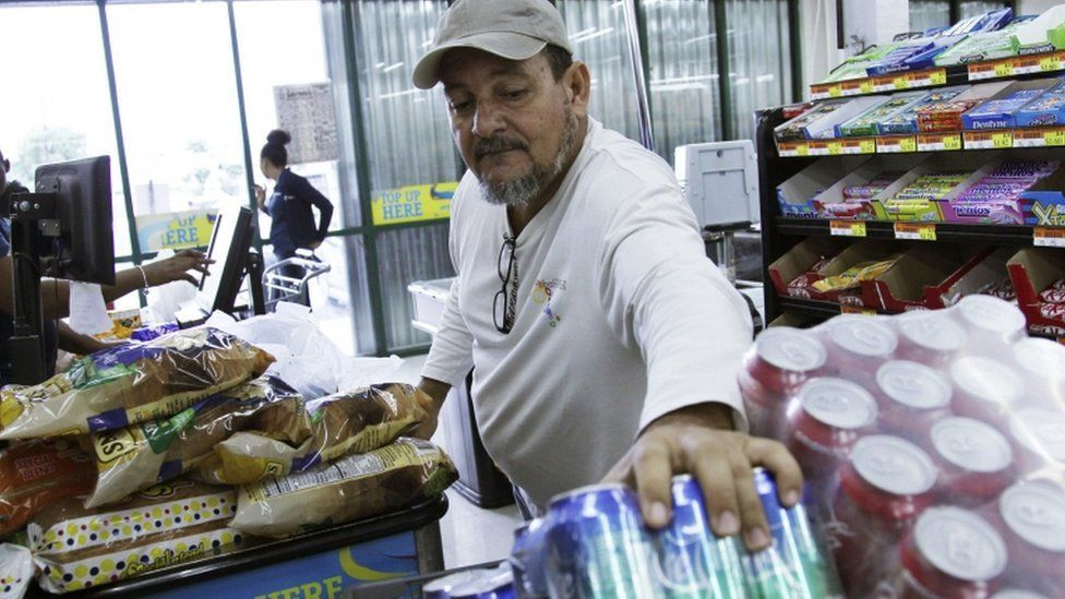 A man picking items in a supermarket in Nassau, Bahamas,