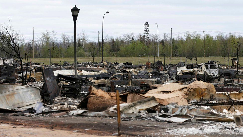 At least ten gutted and charred vehicles