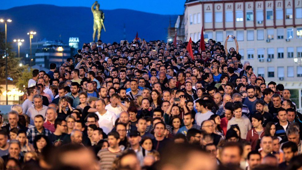 """Protesters walk and shout the slogans during the protest against Macedonian President Gjorge Ivanov""""s decision on wiretapping amnesty, in Skopje"""
