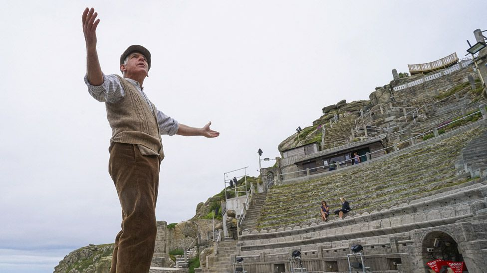 Actor Mark Harandon rehearsing alone at the open air Minack Theatre in Cornwall