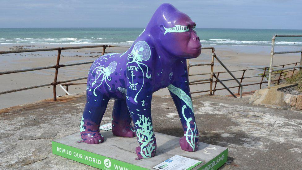 Gorilla statue in front of beach
