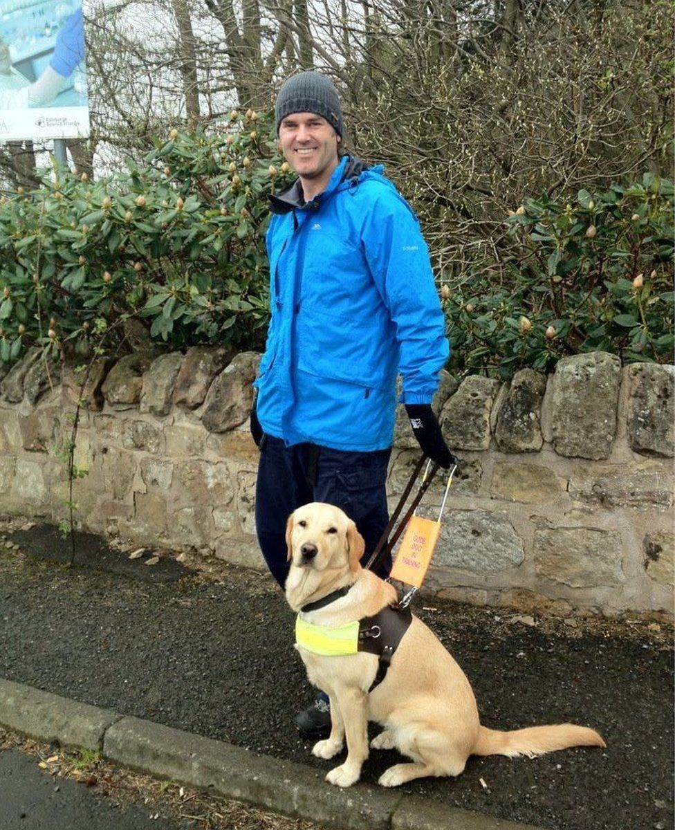 Gavin Neate with guide dog