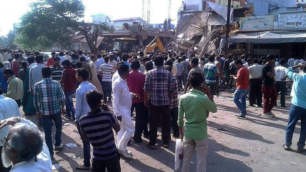 People gather at the site of an explosion in Jhabua, Madhya Pradesh, India, 12 September 2015.