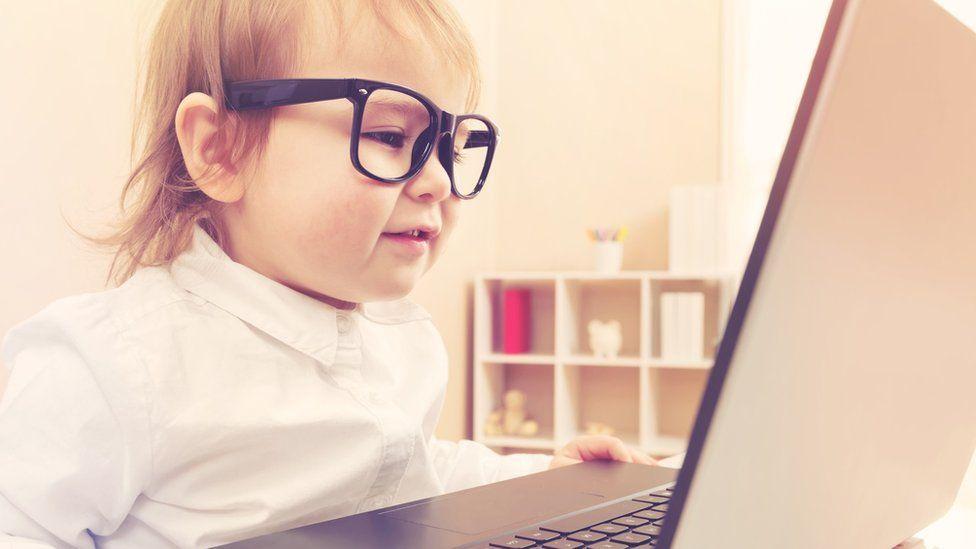 Toddler using laptop