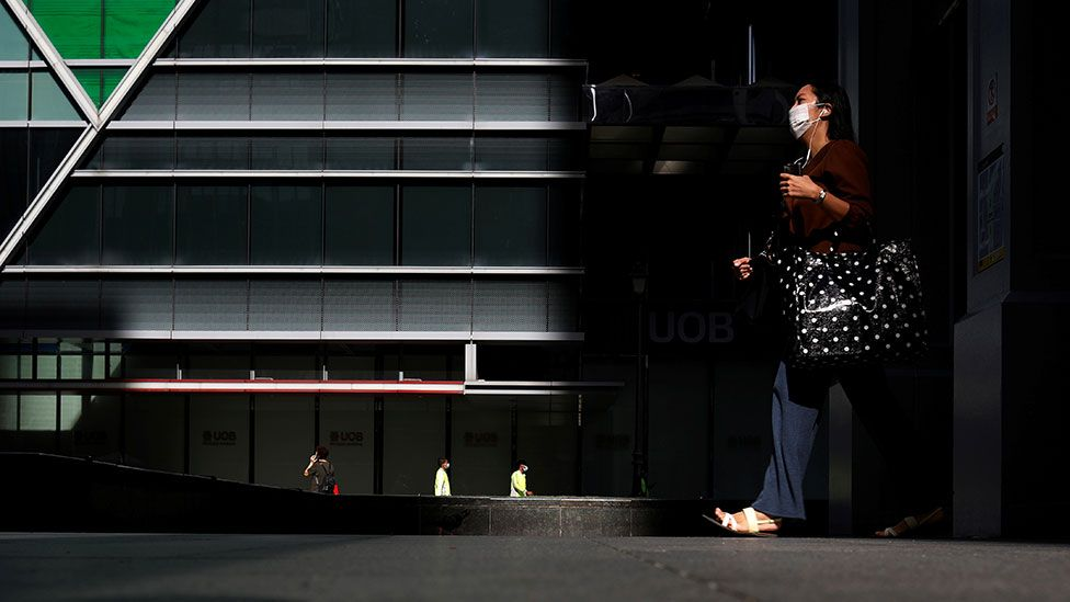 Worker walks through the streets in Singapore's central business district
