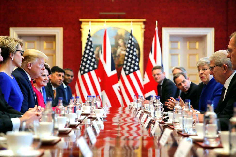 Mr Trump with Theresa May and others at a table