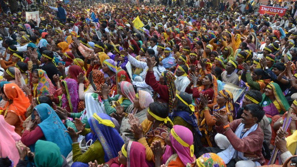 Indian women from the 'dalit' or 'lower caste' shout slogans during a Dalit Dignity Rally against Congress-led UPA government near Parliament House in New Delhi on December 6, 2013. Hu