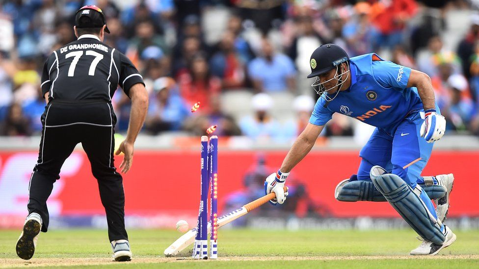 MS Dhoni is run out in the Cricket World Cup semi-final between India and New Zealand