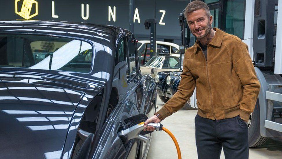 David Beckham charging a Rolls-Royce Lunaz electrified car