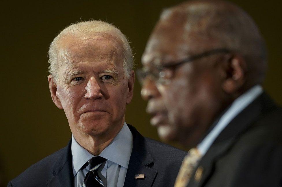 Joe Biden listens to James Clyburn