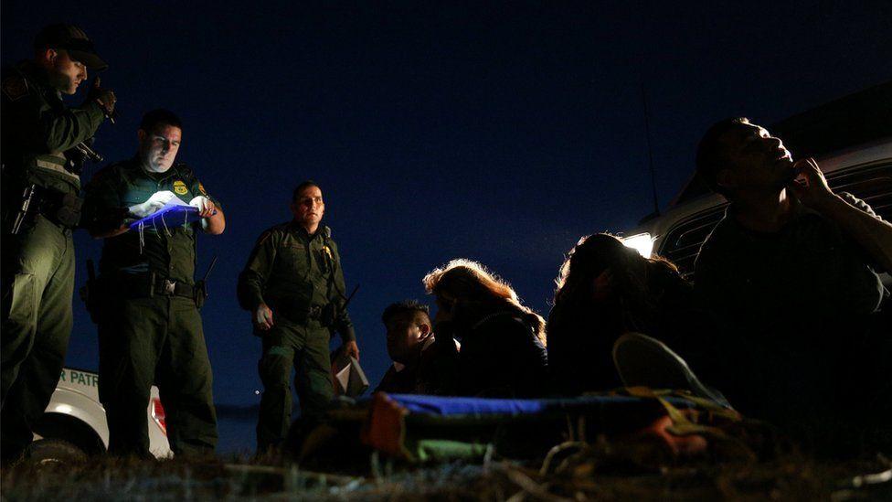 Border patrol agents apprehend immigrants who illegally crossed the Mexico-U.S. border near McAllen