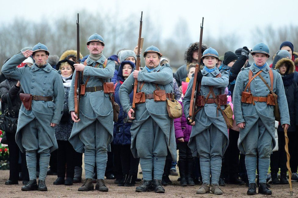 Members of military history clubs wear WWI French military uniform