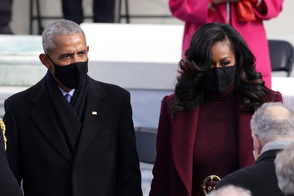 Former President Barack Obama and former first lady Michelle Obama arrive at the inauguration whilst wearing masks