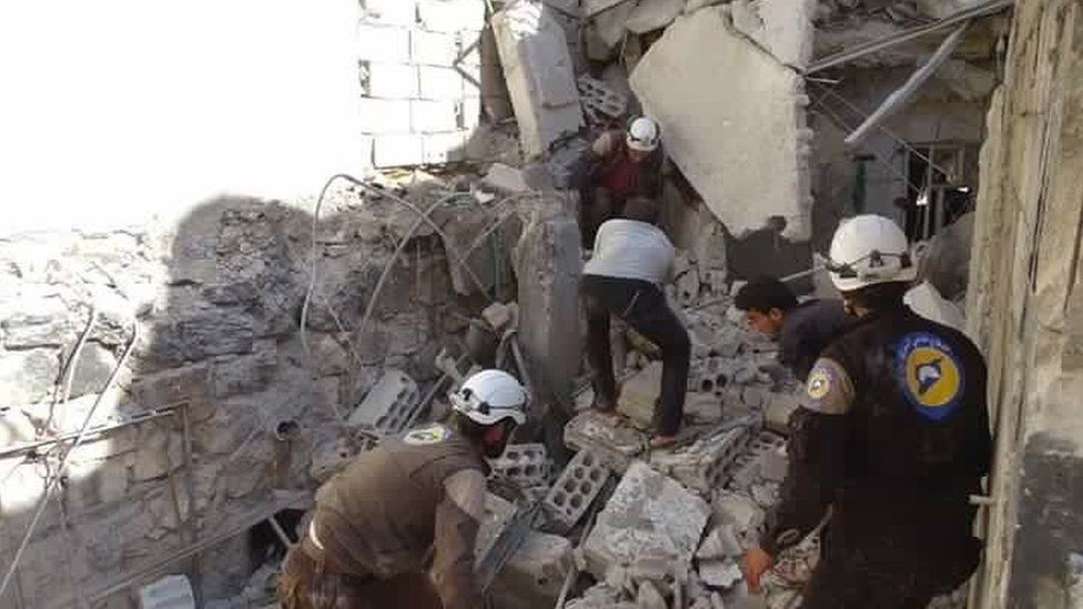 Syria Civil Defence rescue workers at scene of reported air strike in village of Haas, Syria (26 October 2016)