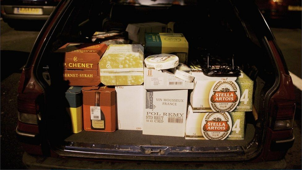 Car boot filled with wine, beer and cheese waits at the Calais ferry port