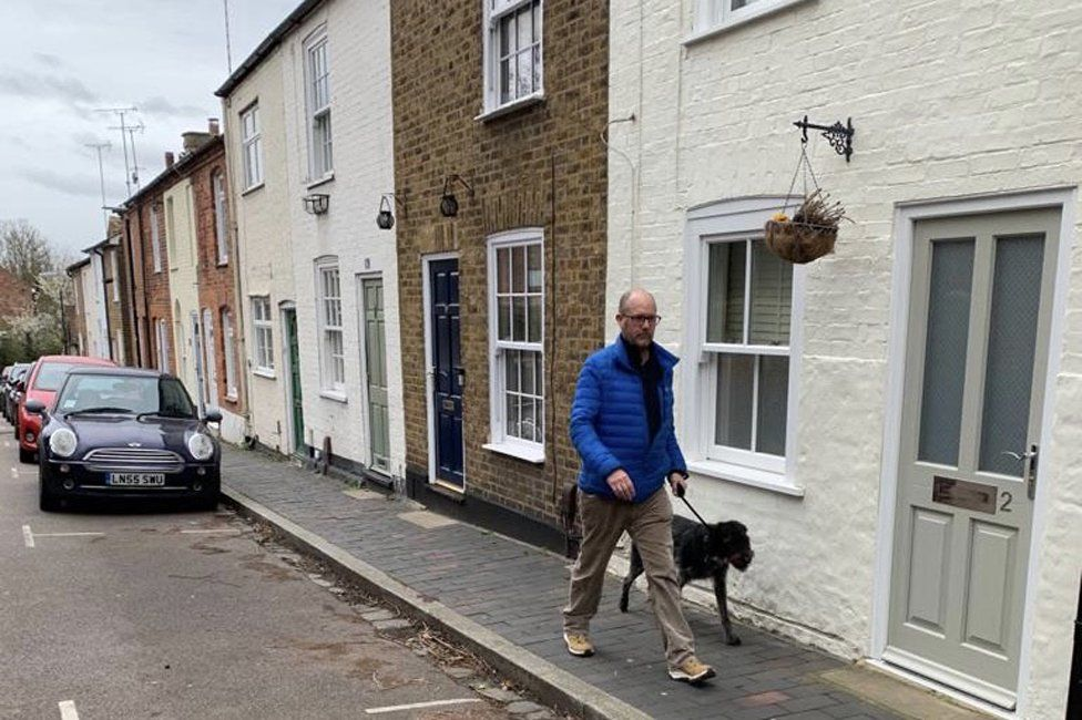 Jim and Heidi walking in St Albans