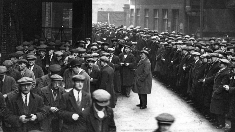 A huge crowd of labourers gathers at the London docks in March 1931 in the hopes of getting some work