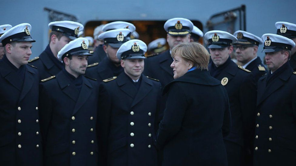 German Chancellor Angela Merkel talks to sailors of the German Navy while she visited the 'Braunschweig' warship on January 19, 2016 in Kiel, Germany.