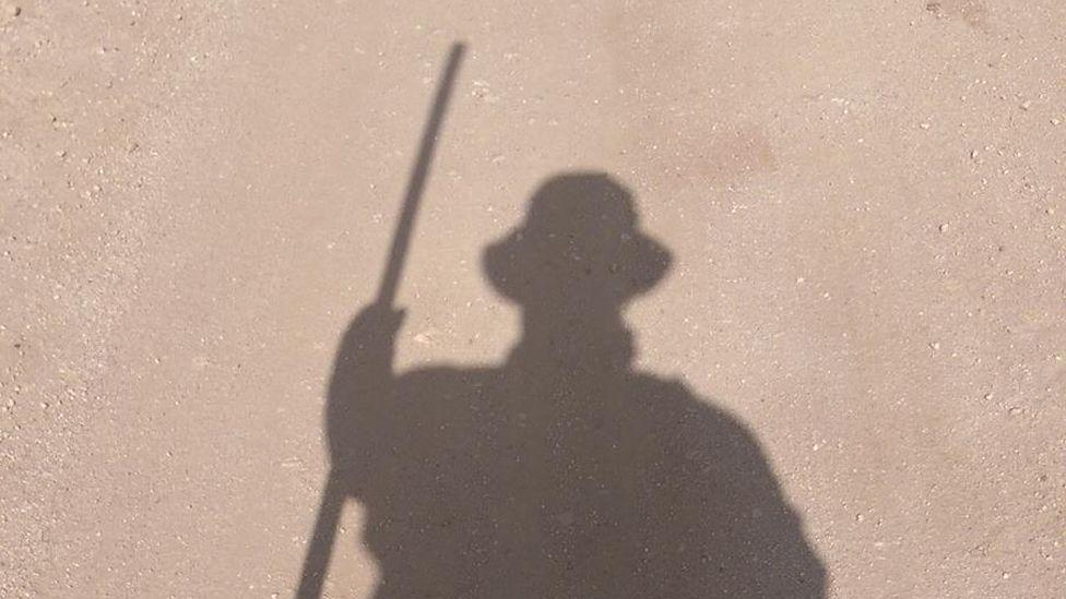 Bob's shadow on the dusty ground