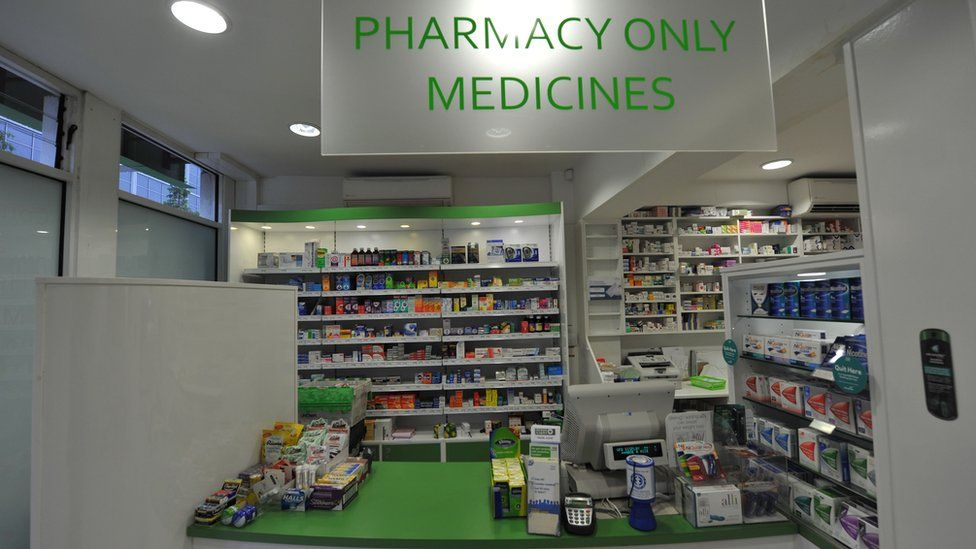 The interior of a pharmacy and its counter