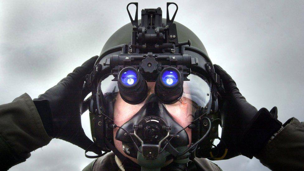 A pilot at RAF Lossiemouth, Scotland, wearing night vision device