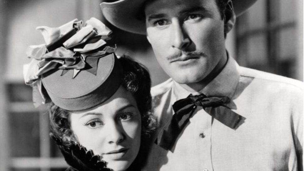 De Havilland with Errol Flynn in Dodge City (1939)