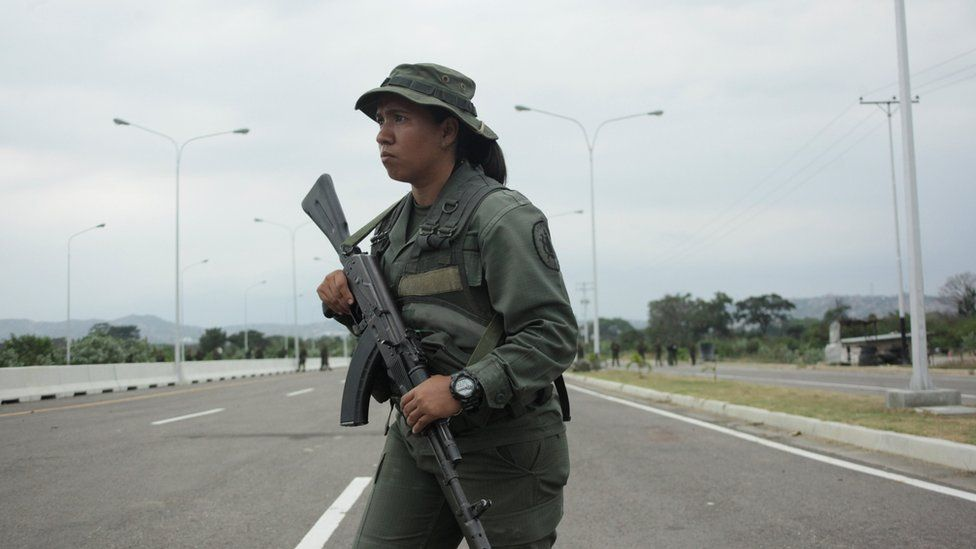 A Venezuelan army member stands guard at the entrance of the Tienditas cross-border bridge between Colombia and Venezuela in Tienditas, Venezuela, February 8, 2019.
