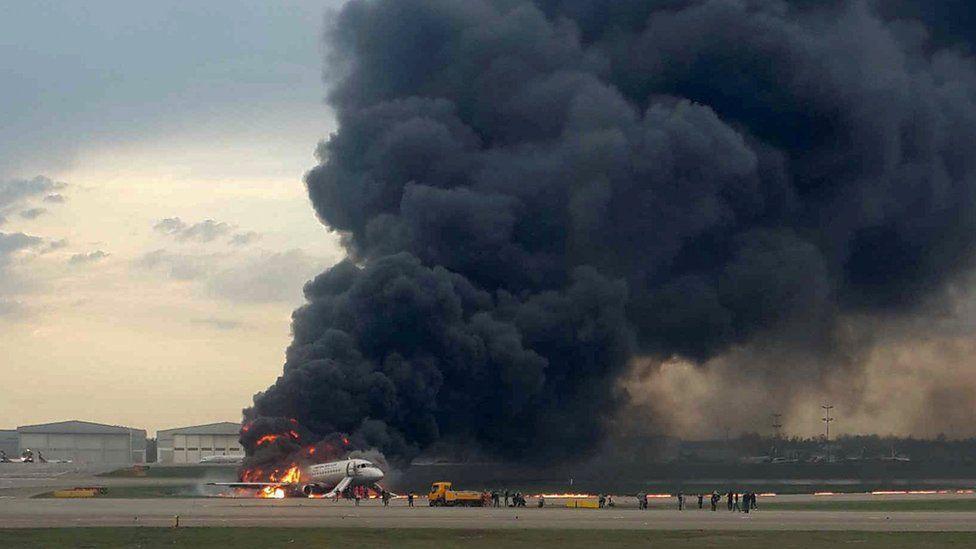 Large fire and smoke engulfs the aircraft