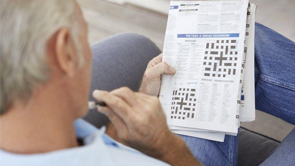 Man doing crossword puzzles