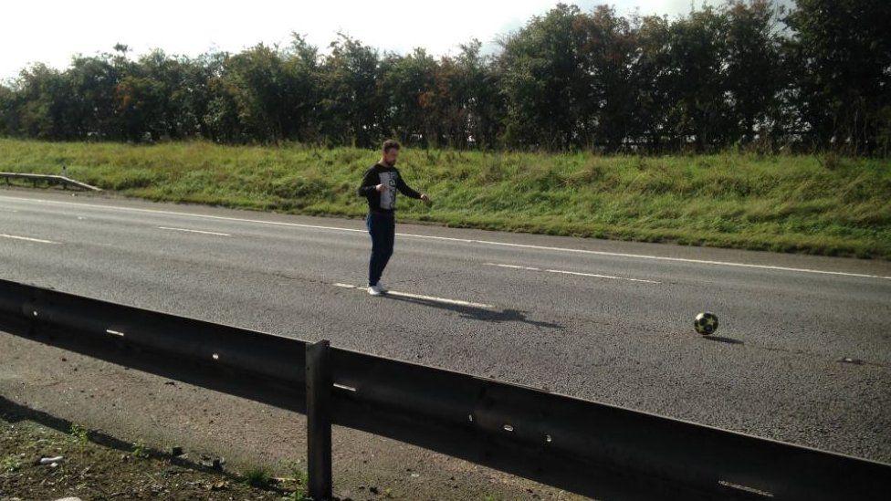 Man playing football on empty M1