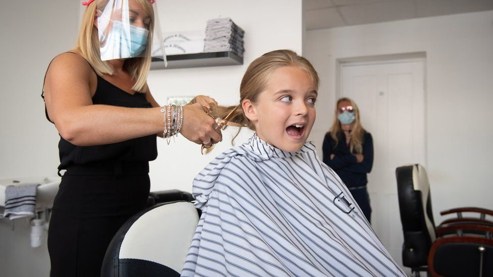 Reilly Stancombe having hair cut
