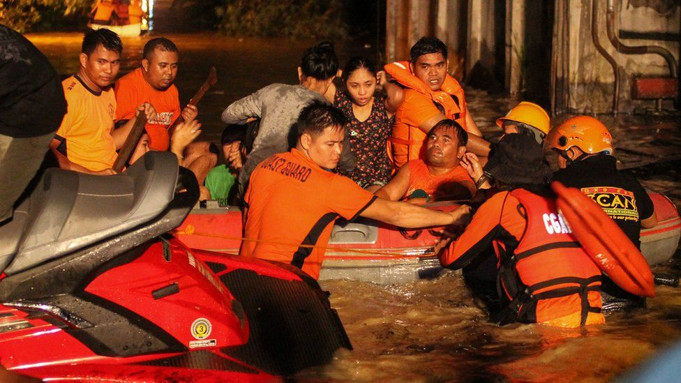People being rescued after a flash flood in Salvador, Philippines, 23 December 2017