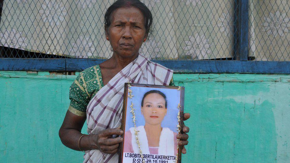 Mariam Kerketta holds a photo of her daughter Bobita