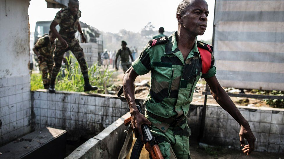 A Gabonese soldier runs to take position as supporters of opposition leader Jean Ping protest