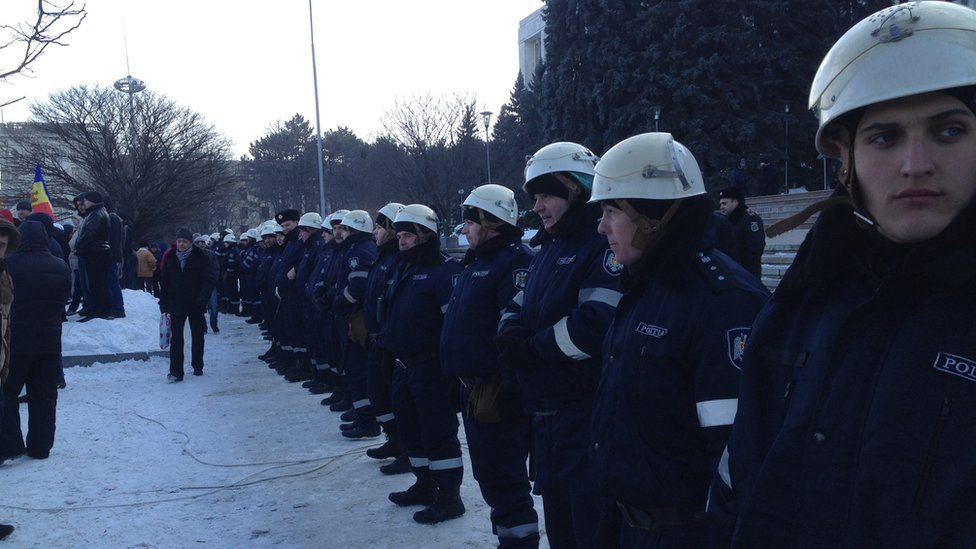 Police form a line in Chisinau to prevent protesters from moving closer