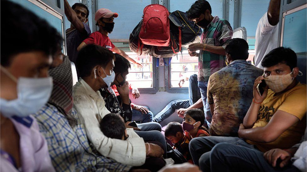 Migrants on board a train from Mumbai to Varanasi on April 9, 2021 in Mumbai, India.