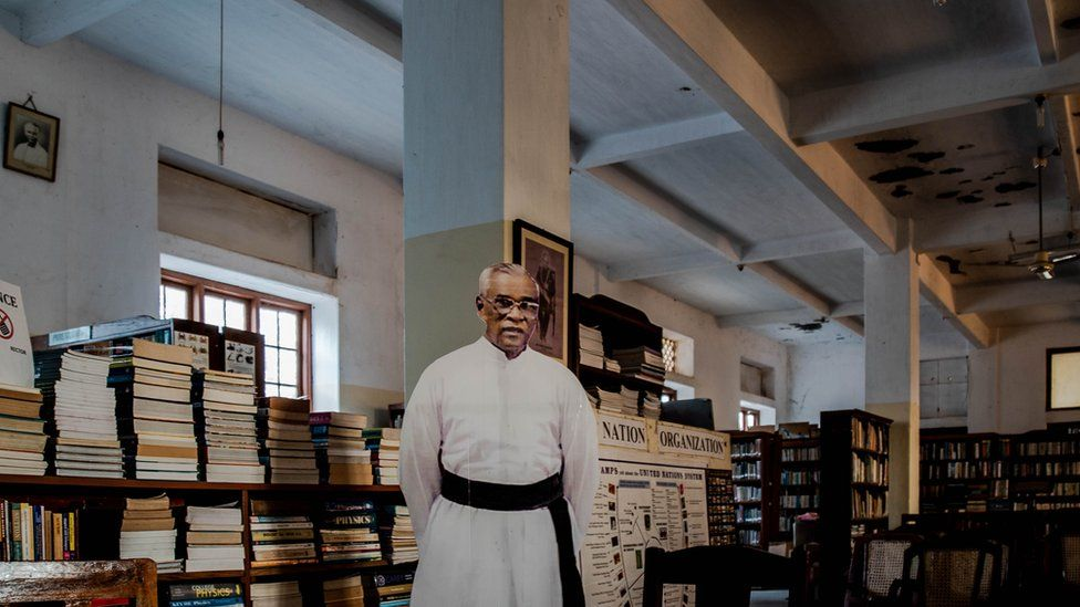 Father Francis cut-out at library