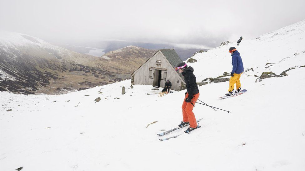 Skiers makes their way down the slope at the Lake District Ski Club on Raise, next to Helvellyn in the Lake District National Park