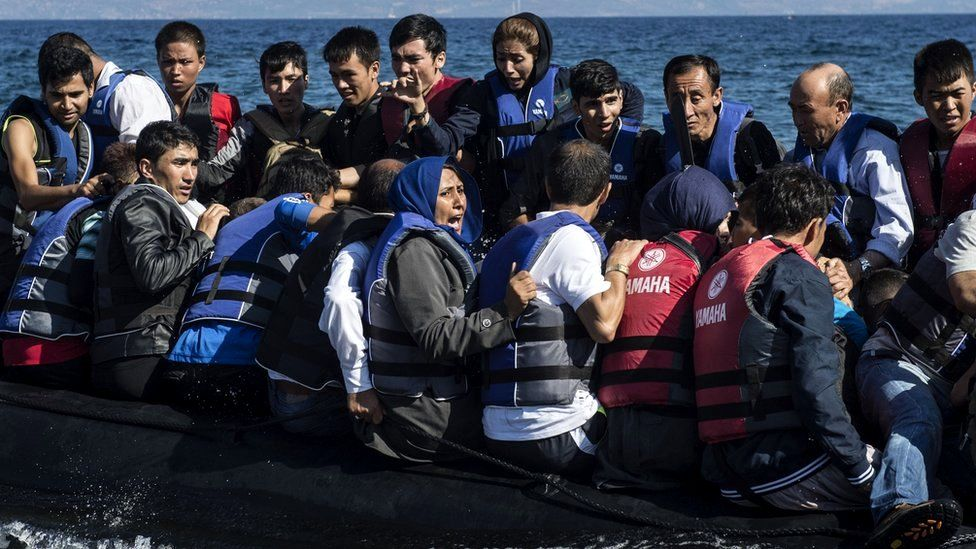 Refugees arrive in an inflatable boat on the Greek island of Lesbos