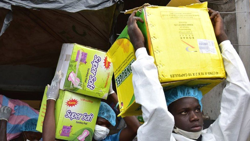 Health Ministry employees load a truck after emptying shops selling fake medicine during a raid monitored by police against shops selling counterfeit drugs on May 3, 2017 at the Adjame market in Abidjan.