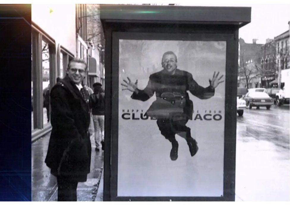 Joe Mimran next to an advert for Club Monaco