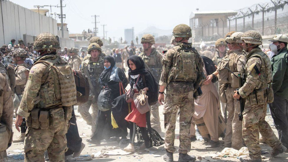 handout image provided by the Ministry of Defence, the British armed forces work with the U.S. military to evacuate eligible civilians and their families out of the country on August 21, 2021 in Kabul,