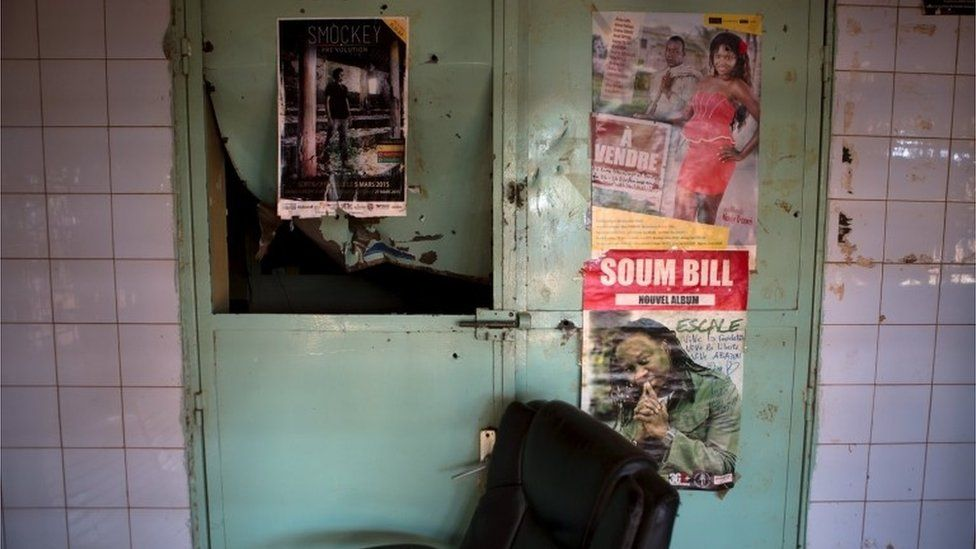 """The damaged entrance of rapper and activist Smockey""""s recording studio, which according to neighbours was attacked by members of the presidential guard, is seen in Ouagadougou, Burkina Faso, September 17, 2015"""