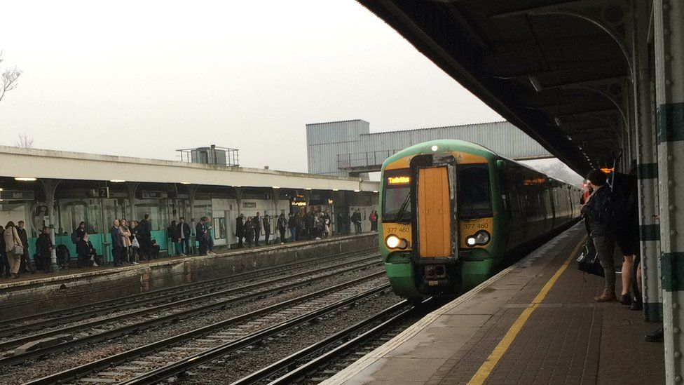 Commuters awaiting a Southern train at Redhill