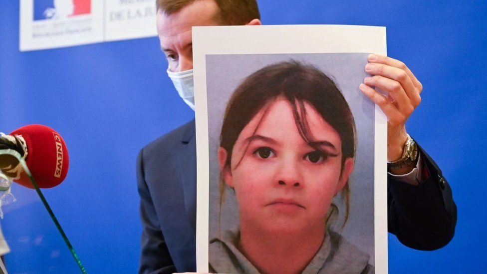 French public prosecutor Nicolas Heitz holds a portrait of missing child Mia Montemaggi during a press conference at The Epinal Courthouse in Epinal, eastern France on April 14, 2021