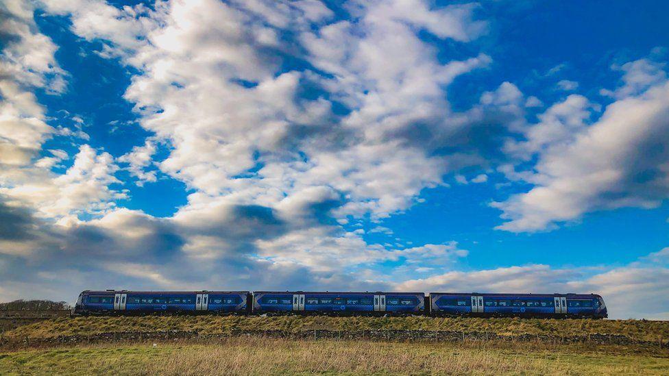 Blue train against blue sky